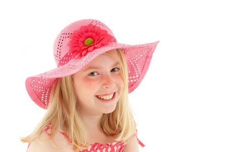 Beautiful young blonde girl with a big smile and wearing a big pink floppy hat. Isolated on white studio background Stock Photo