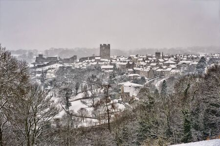 Richmond North Yorkshire, including Richmond Castle on a bleak, cold snowy day Stock Photo