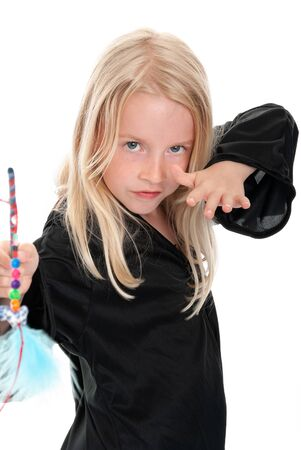 Close up of young blonde girl casting spell in witches costume. Isolated on white Stock Photo