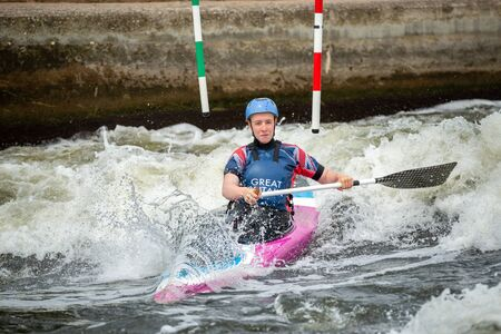 GB Canoe Slalom Athlete crossing white water after negotiating an upstream gate on a wave. Women's C1W class.