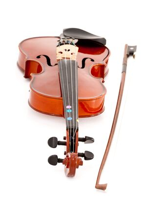 A small viola or violin and bow isolated on a white studio background.