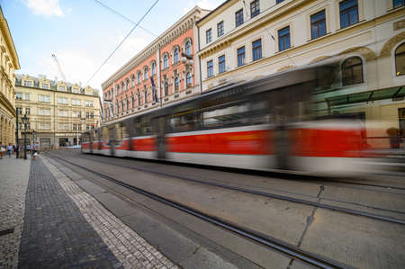 PRAGUE - JULY 20, 2019: Tram with motion blur through cobbled streets of old town district of Prague Editorial