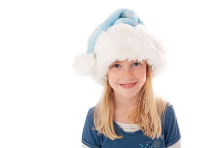 Beautiful young blonde girl in Christmas hat looks smiles at the camera. Isolated on a white studio background.