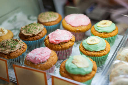Multi coloured cupcakes for sale and on display. Stock fotó