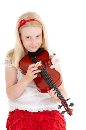 Happy young blonde girl plucking a violin on a white studio background.