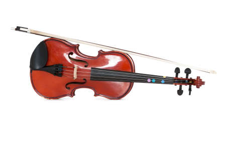 A viola and bow isolated against a white studio background. Foto de archivo