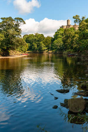 The River Coquet with Warkworth Castle in the background.