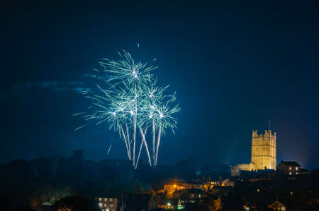 Fireworks display above Richmond Castle, North Yorkshire with houses in the foreground.