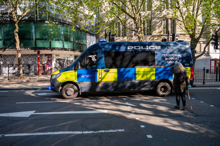 LONDON - MAY 29, 2021: Police Territorial Support Group van on a pedestrian crossing on a London street