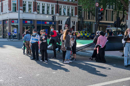 LONDON - MAY 29, 2021: Protesters at a Freedom for Palestine protest rally outside Holborn Tube Station Editorial