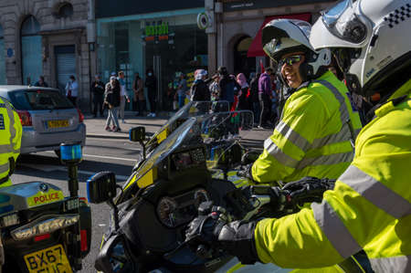 LONDON - MAY 29, 2021: Smiling British police motorcyclist at a Freedom for Palestine protest rally on a London street