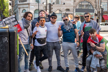 LONDON - MAY 29, 2021: Protesters pose for a photograph at a Freedom for Palestine protest rally outside Holborn Tube Station