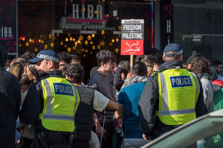LONDON - MAY 29, 2021: British police officers stand guard at a Freedom for Palestine protest rally in London