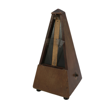 old metronome swinging  photo