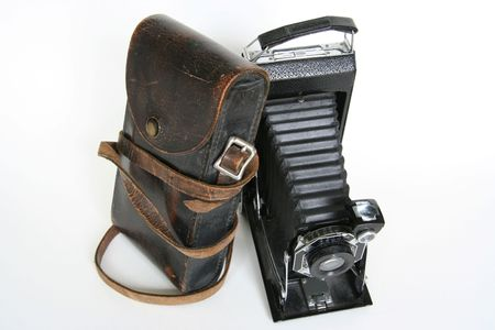 Old Folding Camera with Leather Case Leaning on It