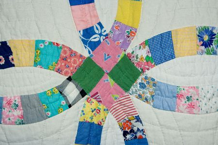 A close-up view of a handmade wedding ring pattern quilt started in the 1930Â's and finished in the 1950Â's