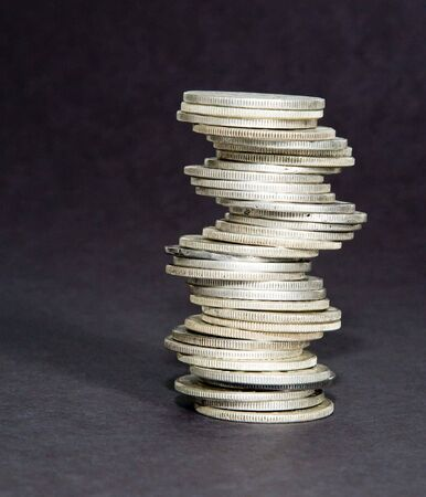 staggered: A staggered stack of silver coins