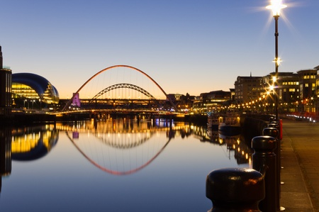 quayside: Reflected Tyne bridges  Illuminated Tyne bridges reflected in the river at twilight