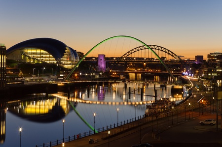 Tyne bridges at twilight / Elevated view of Newcastle and Gatehead quays just as the sun has set