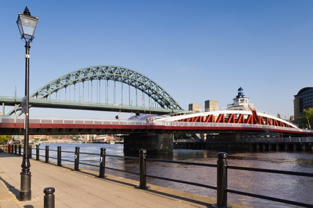 Tyne and Swing bridges / Swing bridge being dwarfed by its well known neighbour the Tyne bridge photo