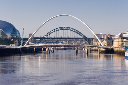 quayside: Arch in arch  In-line arches of the iconic tyne bridges Stock Photo