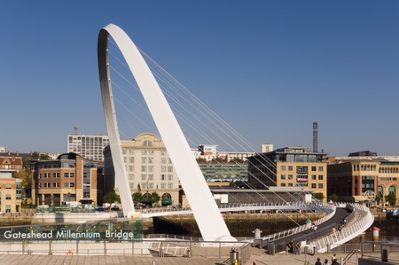 Gateshead Millennium Bridge / Classic view of of the pedestrian bridge showing its name 免版税图像