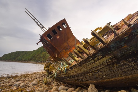 beached: Fishing boat wreck close up showing rust and decay Stock Photo
