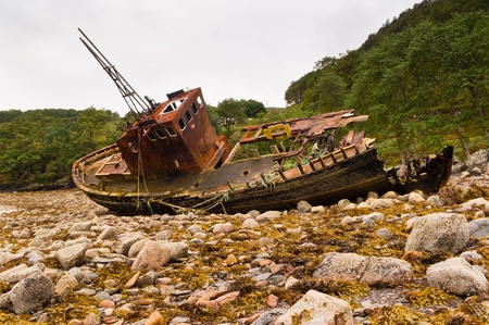 beached: Fishing boat at rest falling into decay