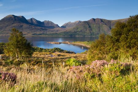 Torridon mountains over Torridon loch on a bright sunny day photo