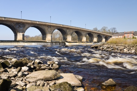 downstream: Hexham Bridge showing arches, weir and rapids downstream