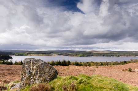 Rock at Kielder water in Kielder national park which has the largest man-made lake in northern europe and largest working forest in england covering 250 square miles photo