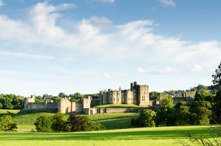 Distant Alnwick Castle is an historic 700 year old medieval castle