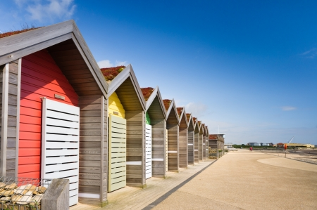 huts: Blyth promenade and colourful beach huts on a sunny day