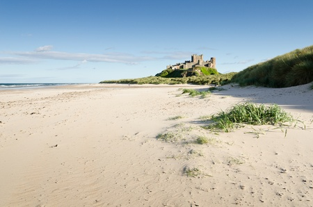 Bamburgh Castle taken from the north beach dates back to the\ 6 7th century\