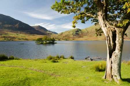 Crummock Water with hollow tree in the English Lake District National Park Stock Photo - 16313146