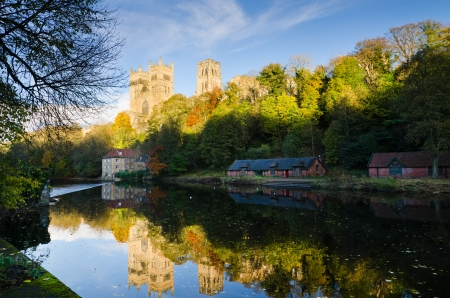 renowned: Autumn reflection of Durham Cathedral which originates from the 11th century and is renowned as a masterpiece of Norman architecture
