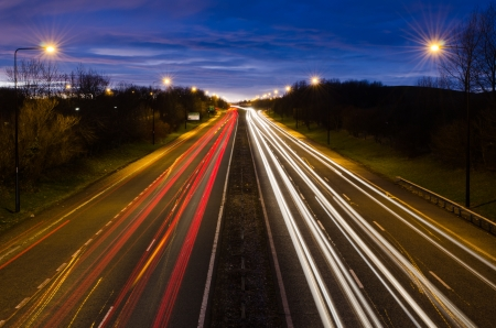 Traffic light trails leaving Newcastle at dusk Stockfoto