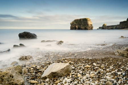 Marsden rock in smooth water and stacks which are the result of erosion over many years