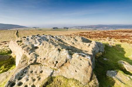 Lordenshaws cup and ring rock art is ancient and prehistoric found on many stones at Lordenshaws in the Simonside Hills part of Northumberland National Park