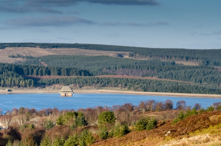 Kielder Dam and valve tower in a park which has the largest man-made lake in northern Europe  Stock Photo