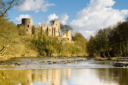 towering: Ruins of Barnard Castle towering above the River Tees