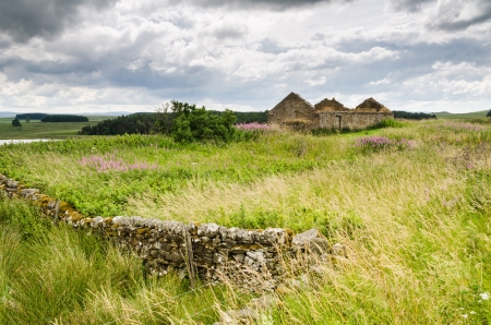 Old derelict cottage just south of Hadrians Wall at Shield on the Wall photo