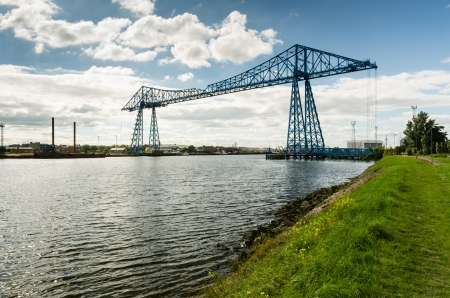 The Middlesbrough Transporter Bridge carries people and cars over the Tees in a suspended gondola Stock Photo - 23109667