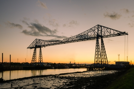 Middlesbrough Transporter Bridge at dusk carries people and cars over the Tees in a suspended gondola