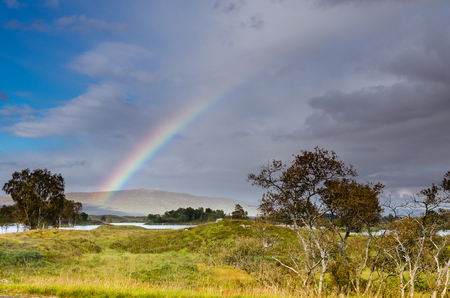 Rainbow over Rannoch Moor and Loch Ba photo