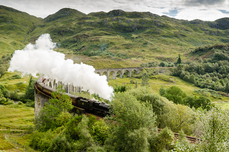 jacobite: Steam train on Glenfinnan Viaduct which carries it from Fort William to Mallaig