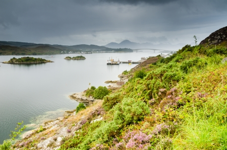 kyle: The Skye Bridge spans Loch Alsh on a cloudy day Stock Photo