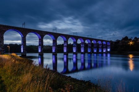 Blue Royal Border Bridge at Berwick is a viaduct that supports the main east coast railway line over the River Tweed Stock Photo - 23836926