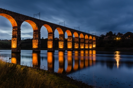 Red Royal Border Bridge at Berwick is a viaduct that supports the main east coast railway line over the River Tweed