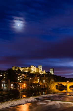 Moon above Durham City skyline which is dominated by its medieval castle and cathedral both sitting high above the River Wear